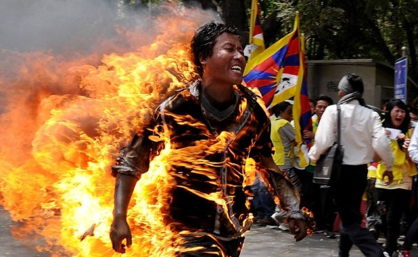 Tibetan exile Jamphel Yeshi, 27, runs as he is engulfed in flames after he set himself on fire during a protest in New Delhi last march. Tibetans at the rally were protesting against an upcoming visit to India by Chinese President Hu Jintao, according to police. Self-immolation is common among Tibetans protesting against Chinese rule.