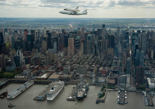 This photo provided by NASA shows space shuttle Enterprise, mounted atop a NASA 747 Shuttle Carrier Aircraft (SCA), flying near the Intrepid Sea, Air and Space Museum on April 27, 2012, in New York. Enterprise was the first shuttle orbiter built for NASA performing test flights in the atmosphere and was incapable of spaceflight. Originally housed at the Smithsonian's Steven F. Udvar-Hazy Center, Enterprise will be demated from the SCA and placed on a barge that will eventually be moved by tugboat up the Hudson River to the Intrepid Sea, Air and Space Museum in June.