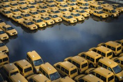 New taxi cabs in a flooded car park in New Jersey after Hurricane Sandy made landfall in October. The superstorm devastated the Northwestern United States, costing an estimated $65 billion of damage. At least 250 people were killed in seven countries along the storm's path.