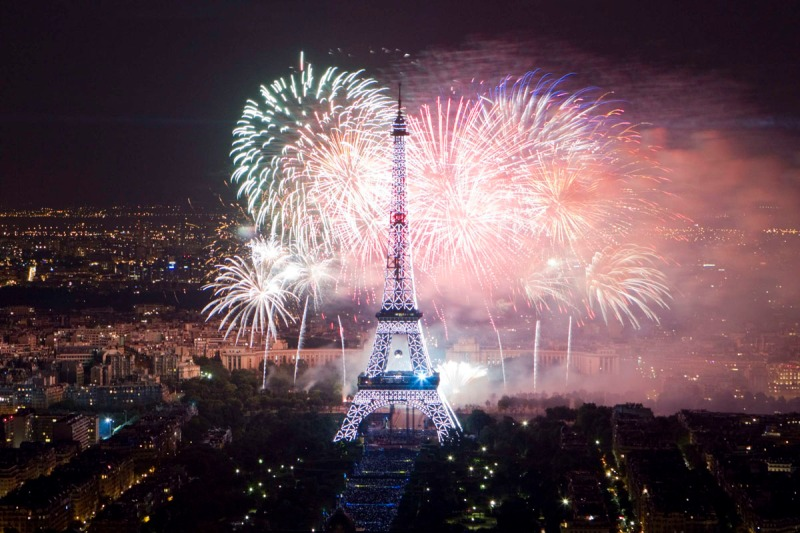 The Eiffel Tower is illuminated during the traditional Bastille Day fireworks display in Paris